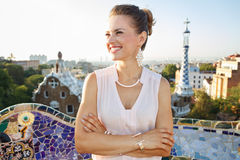 Happy woman tourist in Park Guell, Barcelona looking aside Royalty Free Stock Photo