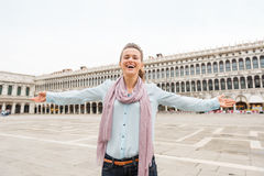 Happy woman tourist rejoicing on St. Marks Square Royalty Free Stock Photos