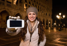 Happy woman tourist showing smartphone on St. Marks Square Royalty Free Stock Photo
