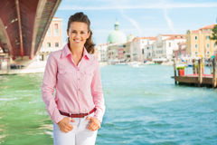 Happy  woman tourist standing near Grand Canal in Venice Stock Image