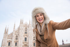Happy woman tourist taking selfie in the front of Duomo, Milan Royalty Free Stock Photos