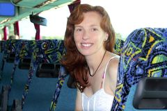 Happy woman tourist traveling bus indoor Royalty Free Stock Photos