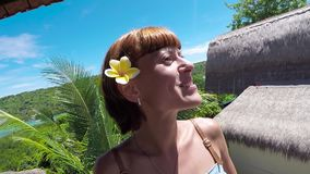 Happy woman tourist on a tropical island Nusa Lembongan, Bali, Indonesia. Girl traveler looking around joyful and happy. Happy woman tourist on a tropical island stock video