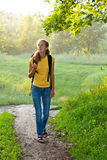 Happy Woman Tourist Walking in Summer Nature Royalty Free Stock Images