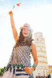 Happy woman tourist waving flag at Leaning Tower of Pisa Royalty Free Stock Photo