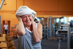 Happy woman with towel in gym Stock Photography