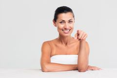 Happy woman in towel pointing finger at camera Royalty Free Stock Photography