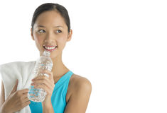 Happy Woman With Towel And Water Bottle Looking Sideways Royalty Free Stock Image
