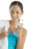 Happy Woman With Towel And Water Bottle Royalty Free Stock Photography