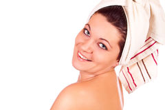 Happy woman with a towel wrapped on her head Royalty Free Stock Photos