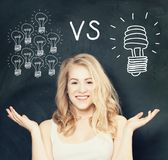 Happy Woman with traditional and energy efficient light bulbs stock photography