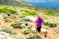 Happy woman trail running in beautiful mountains Stock Image