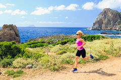 Happy woman trail running in beautiful mountains Stock Photos