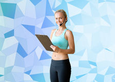 Happy woman trainer with microphone and clipboard Royalty Free Stock Image