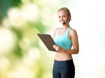 Happy woman trainer with microphone and clipboard Stock Photography
