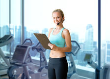 Happy woman trainer with microphone and clipboard Stock Image