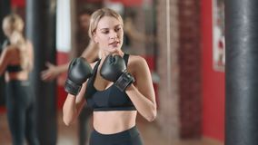 Happy woman training box fight with personal trainer in gym together. stock video