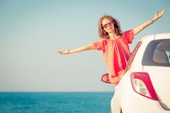 Happy woman travel by car stock image