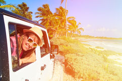 Happy woman travel by car on tropical beach Stock Photo
