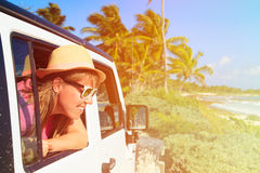 Happy woman travel by car on tropical beach Royalty Free Stock Image
