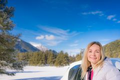 Happy woman travel by car in winter Stock Photos