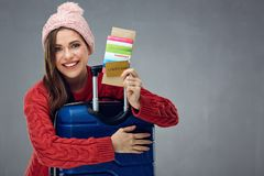 Happy woman with travel case holding passport, ticket and credit Royalty Free Stock Images