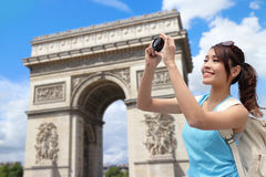 Happy woman travel in Paris. Arc de Triomphe , she take photo by camera Royalty Free Stock Images
