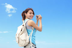 Happy woman traveler photo by camera Stock Photo