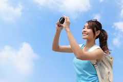 Happy woman traveler photo by camera Stock Images