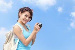 Happy woman traveler photo by camera Stock Photo