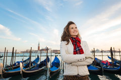 Happy woman traveler standing on embankment in Venice, Italy Stock Image