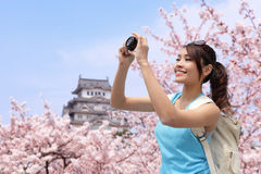 Happy woman traveler take a photo Stock Photos