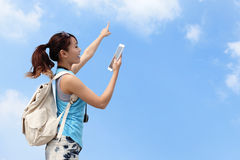 Happy woman traveler use tablet pc Royalty Free Stock Photography