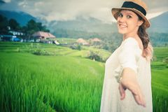Happy woman traveling in jatiluwih rice terrace, Bali, Indonesia. Royalty Free Stock Photography