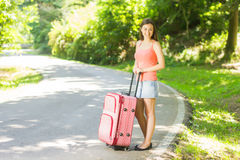 Happy woman traveling Stock Images