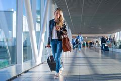Free Happy Woman Travelling And Walking In Airport Stock Photo - 105309920