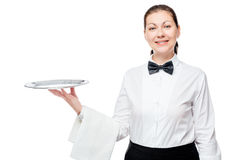 Happy woman with a tray works as a waitress. On a white background royalty free stock photo