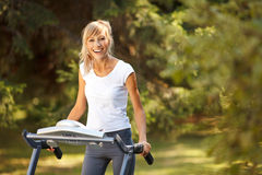 Happy woman on the treadmill Stock Photo