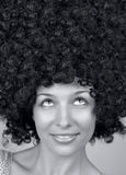 Happy woman with trendy curly hair style. Portrait of happy woman with trendy hair style royalty free stock images