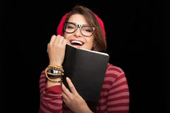 Happy Woman in Trendy Fashion Holding a Notebook Royalty Free Stock Photos