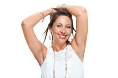 Happy Woman in Trendy Outfit Holding her Hair Up Royalty Free Stock Images