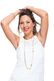 Happy Woman in Trendy Outfit Holding her Hair Up Royalty Free Stock Photography
