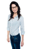 Happy woman in trendy wear. Shirt and jeans Stock Images