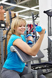 Happy woman tries dumbbell in sport shop Stock Photos
