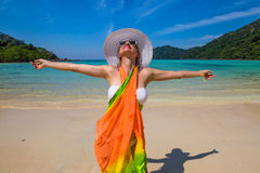 Happy woman on tropical beach Royalty Free Stock Image