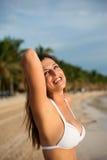 Happy woman at tropical beach. Joyful happy woman at caribbean tropical beach having fun on summer vacation. Beautiful girl in white bikini on travel to Riviera Royalty Free Stock Photo