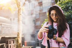 Beautiful traveler female posing with camera. stock images