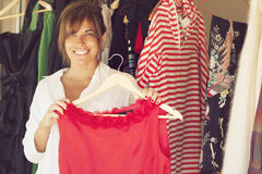Happy woman trying clothes royalty free stock images