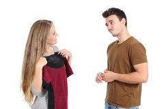 Happy woman trying clothes shopping with her boyfriend Stock Images