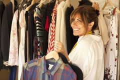 Happy woman trying clothes Stock Photography